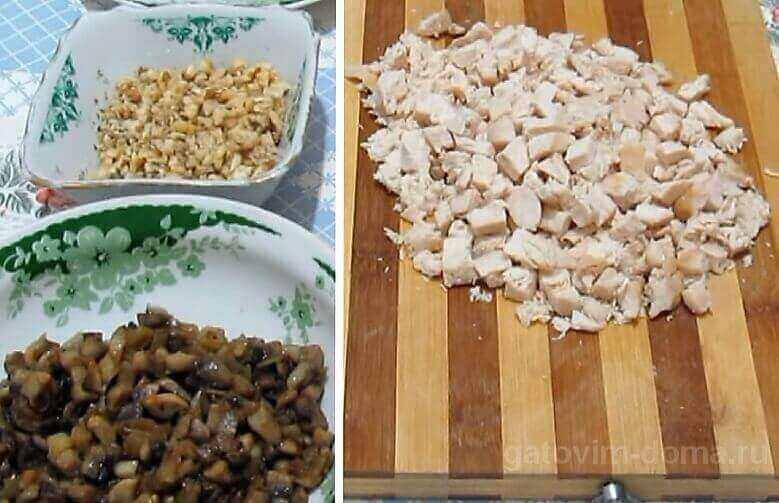 Нарезанные кубиками курица, грибы и измельченные грецкие орехи