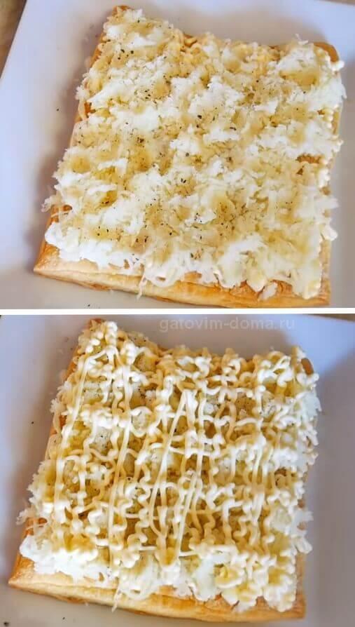 Слой натертого отварного картофеля с майонезом в салате Мимоза